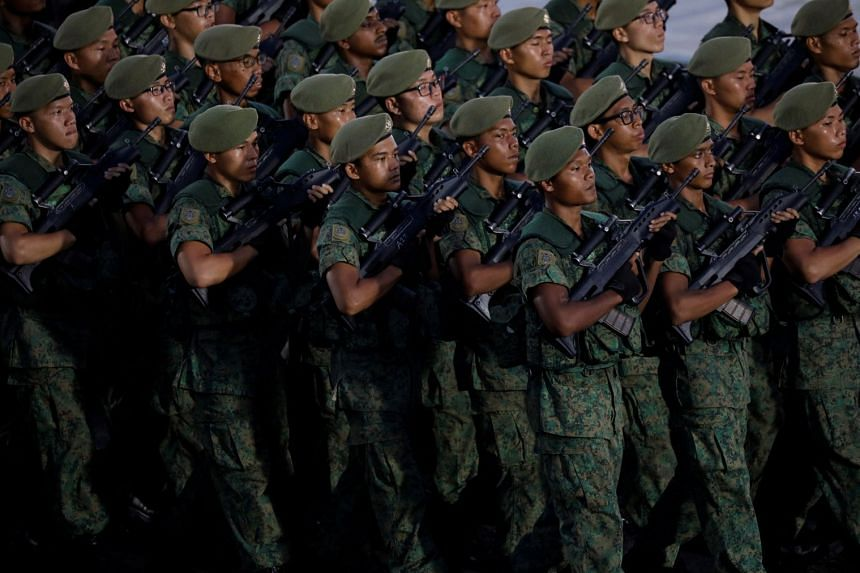 A contingent of infantry soldiers march during Singapore's 52nd National Day celebrations at Marina Bay, Singapore August 9, 2017.