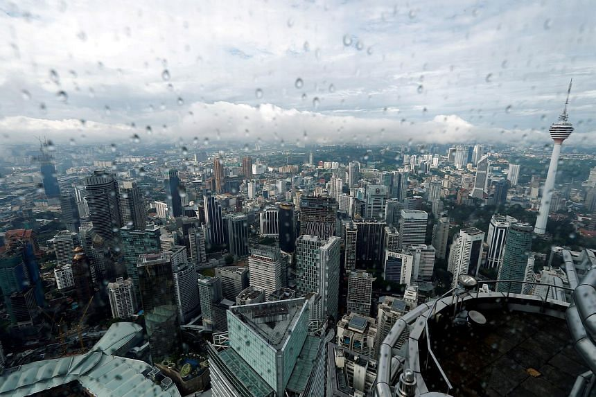 A view of the Kuala Lumpur city skyline in Malaysia, Aug 15, 2017. Downpours are dousing any chance of haze throughout the 29th SEA Games in Kuala Lumpur.
