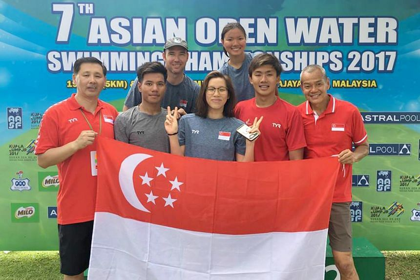 Singapore's representatives at the Asian Open Water Swimming Championships 2017 in Kuala Lumpur, Benedict Boon (second from left), Chantal Liew (middle), Chin Khar Yi (third from right) and Erasmus Ang (second from right).