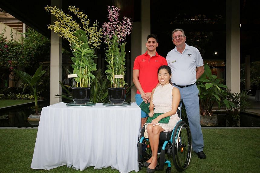 Dendrobium Joseph Schooling (left) and Dendrobium Yip Pin Xiu (right) at a ceremony in the Singapore Botanic Gardens' Botany Centre on Aug 7,2017.