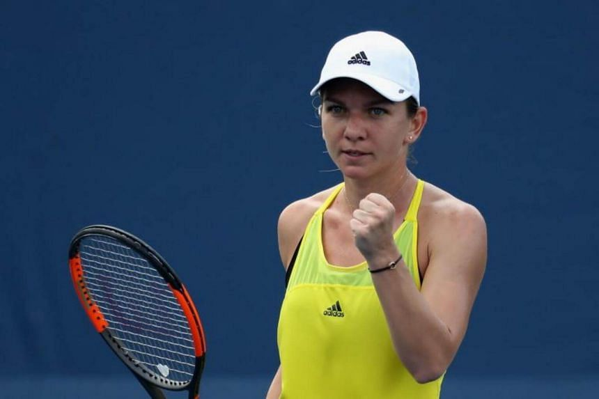 Simona Halep of Romania celebrates winning a point against Anastasija Sevastova of Latvia during Day 6 of the Western and Southern Open at the Linder Family Tennis Center on Aug 17, 2017 in Mason, Ohio.