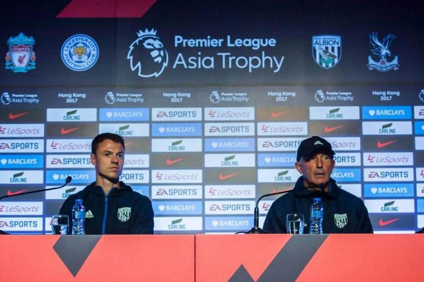 West Bromwich Albion Football Club manager Tony Pulis (right) and player Jonny Evans attend a press conference in Hong Kong on July 18, 2017.