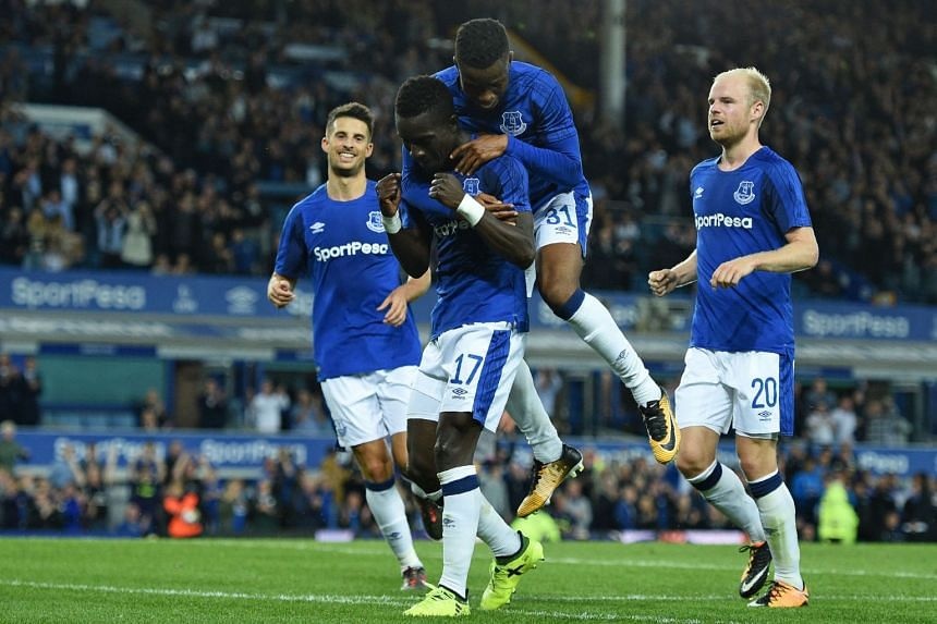 Everton's Idrissa Gueye celebrates with teammates after scoring their second goal.