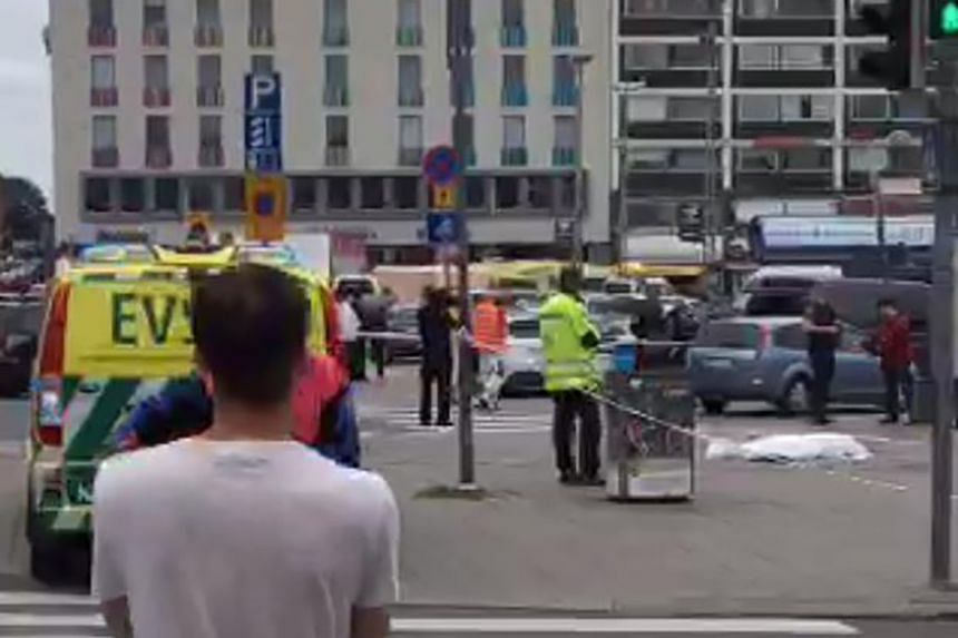 A video grab shows officials standing in a street in the Finnish city of Turku where several people were stabbed.