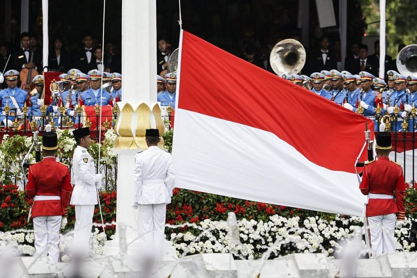 Indonesian flag bearers hoist the Indonesian national flag during a ceremony to mark the 72nd Independence Day in Jakarta on Aug 17, 2017.
