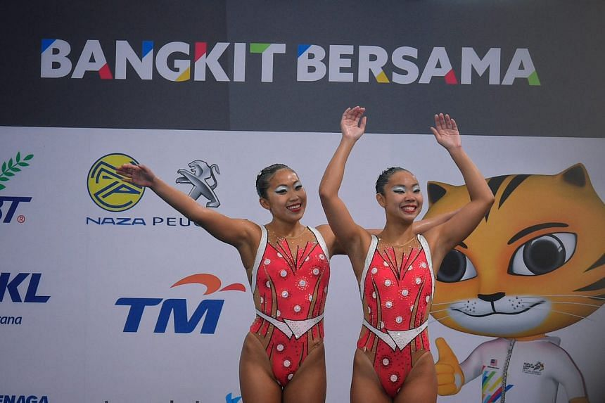 Miya Yong and Debbie Soh of Singapore in action during their gold medal-winning routine.