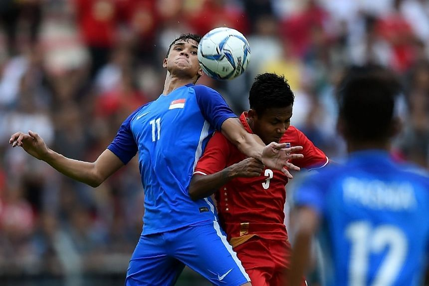 Ikhsan Fandi Ahmad (left) of Singapore fights for the ball with Htike Htike Aung of Myanmar during their men's football Group A round match at the 29th Southeast Asian Games (SEA Games) at Selayang Stadium, outside Kuala Lumpur, on August 14, 2017.
