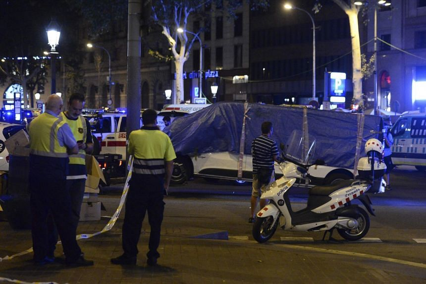 The van that ploughed into the crowd, killing at least 13 people and injuring around 100 others being towed away from the Rambla in Barcelona, on Aug 18, 2017.