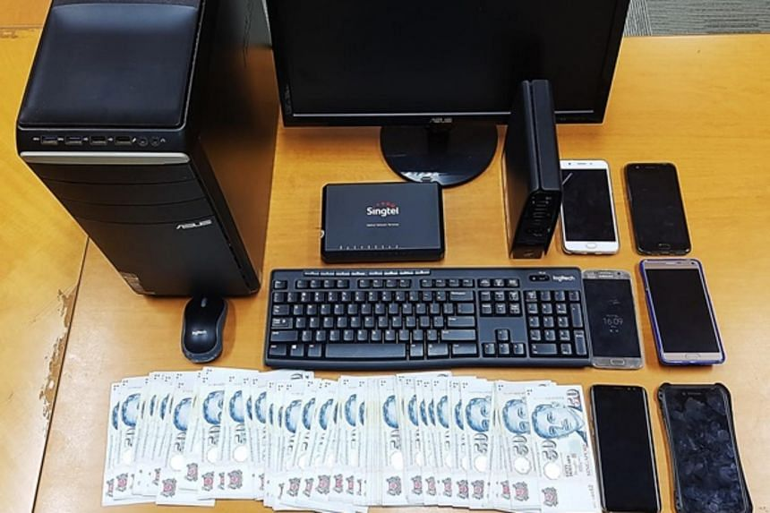 Criminal Investigation Department officers seized about $4,000 worth of cash, a computer and a mobile phones as case exhibits in the raid on Wednesday (Aug 16).