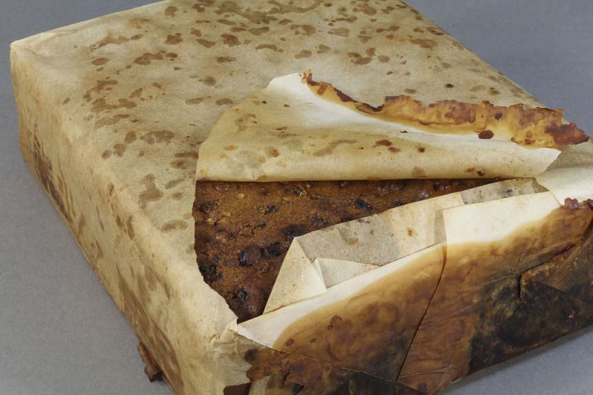 """A photo of the fruitcake from the Antarctic Heritage Trust. The dessert, found wrapped in paper and in its original """"tin-plated iron alloy tin"""" container, was made by the British biscuit company Huntley & Palmers."""