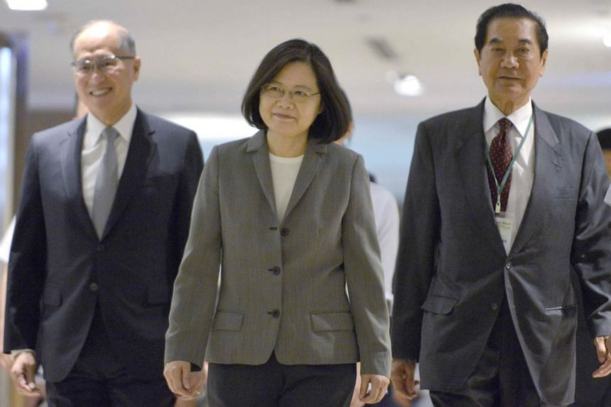 Taiwan's President Tsai Ing-wen (centre) is escorted by Foreign Minister David Lee (left) and Chairman of the Taiwan Prospective Foundation Chen Tan-sun while attending the Asia-Pacific Security Dialogue in Taipei, on Aug 8, 2017.