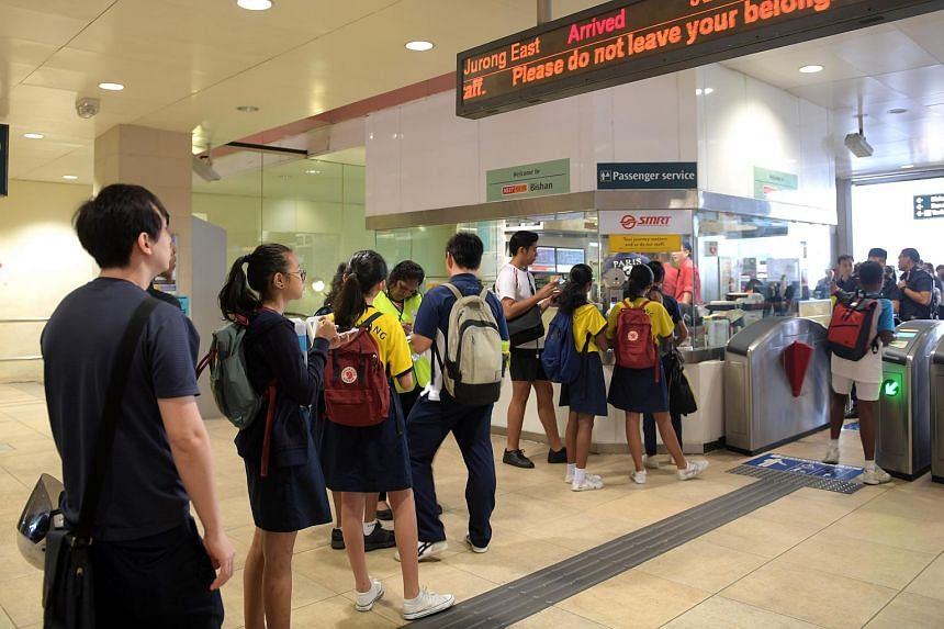 Students queue up to get a time chit from SMRT.