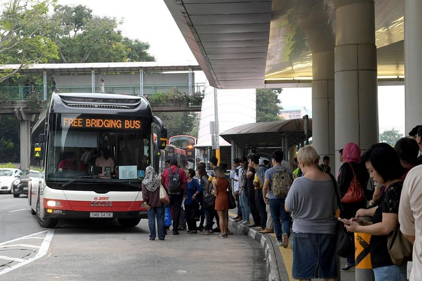 Commuters waiting for the free bus services at Bishan MRT station on Friday morning.