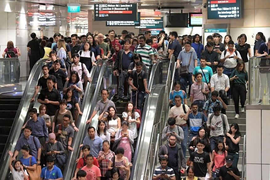 The crowd at Bishan MRT station on Friday, at about 8.30am. ST PHOTO: JAMIE KOH