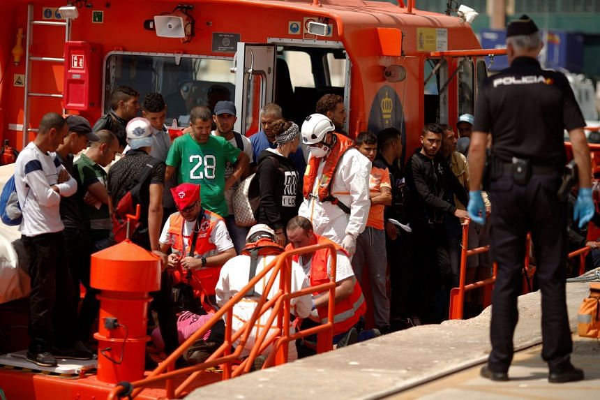 Migrants intercepted aboard a dinghy in the Mediterranean sea arrive at a port in Malaga, Spain, Aug 18, 2017.