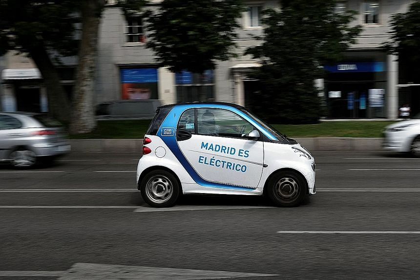 """Madrid's city council allows electric vehicles to circulate in restricted zones and park almost anywhere for free. The words on the door reads, """"Madrid is electric""""."""