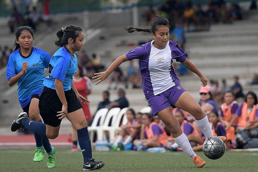 Tournament favourites Queensway Secondary School clinched the Schools National C Division girls' football title yesterday, beating rivals Bowen Secondary School 1-0 in a tense affair. Golden boot winner Putri Nur Syaliza (in purple), who scored an in