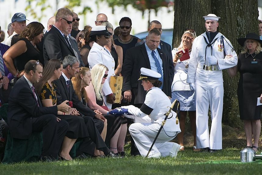 A service for a USS Fitzgerald crew member, held at Arlington National Cemetery in Virginia, on Wednesday. Seven US sailors died after the warship collided with a Philippine cargo ship off Tokyo Bay.