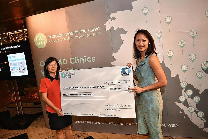 Ms Tan Bee Heong (at left), general manager of The Straits Times School Pocket Money Fund, received a cheque for $38,000 from the managing director of Novu Medical Aesthetic Clinic, Ms Jennifer Loh, at the company's private patient appreciation event