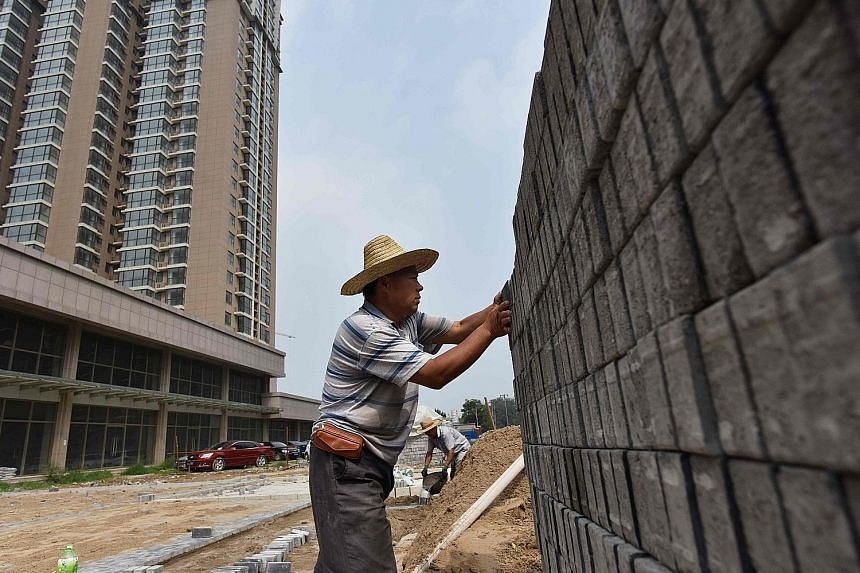 A construction site of a housing complex in Beijing. Government restrictions to keep home prices in check weighed on larger cities, with July showing the slowest growth since August 2016.