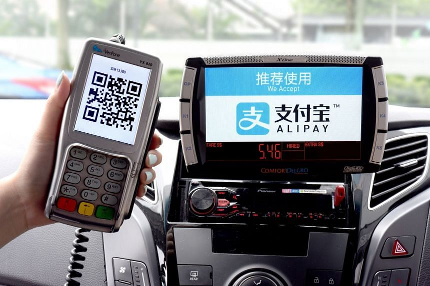Commuters taking ComfortDelgro taxis can now pay their fares using digital wallet application Alipay.
