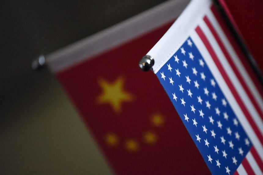Chinese and American flags are displayed at a company in Beijing, Aug 16, 2017.