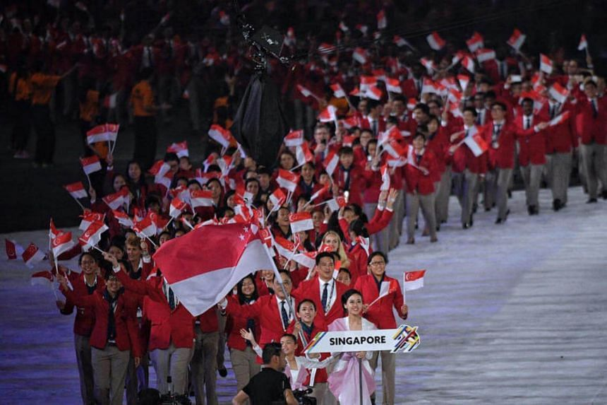 The Singapore contingent, lead by shooter Jasmine Ser, walk out during the athlete's parade at the opening ceremony of the 29th SEA Games at the National Stadium in Bukit Jalil on Saturday, Aug 19, 2017.
