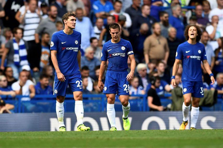 Chelsea's Andreas Christensen and Cesar Azpilicueta look dejected after Burnley's Sam Vokes scores their third goal, on Aug 12, 2017.