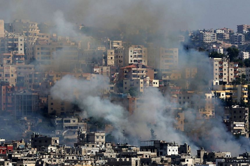 Smoke rises from buildings in Ain el-Helweh, Lebanon's largest Palestinian refugee camp.