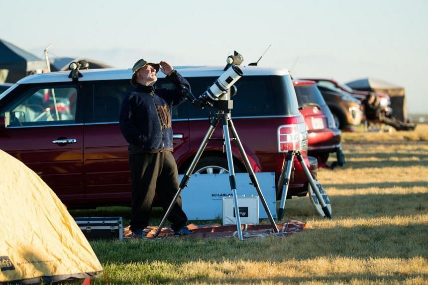 Total solar eclipse enthusiasts gather in Madras, Oregon, on Aug 18, 2017.