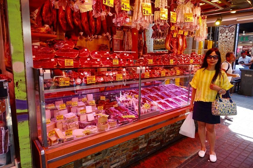 Singaporean Sharon Sheares standing at the La Boqueria market, on Aug 16, 2017,  next to Las Ramblas street in Barcelona, which was hit by a terrorist attack, on Aug 17.