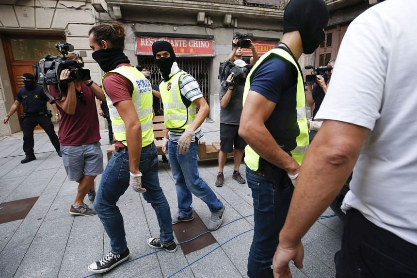 Police officers in Ripoll after they had carried out a search linked to the deadly terror attacks in Barcelona and Cambrils.