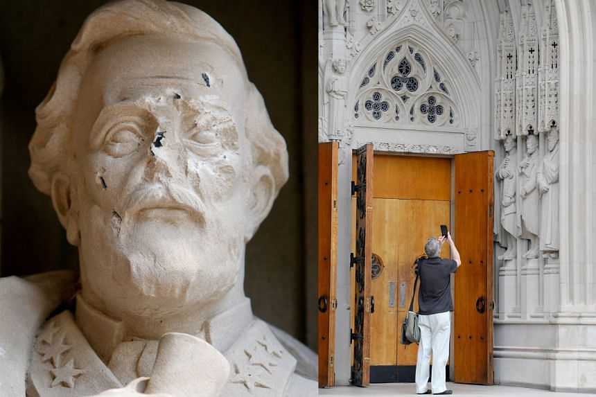 Left: A close-up view of the damage. Right: A statue of Confederate General Robert E. Lee (middle statue) at Duke University in North Carolina was vandalised on Thursday.