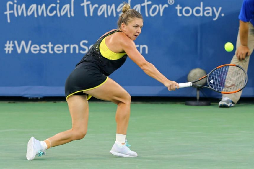 Simona Halep (ROU) returns a shot against Johanna Konta (GBR) during the Western and Southern Open at the Lindner Family Tennis Center on Aug 18, 2017.