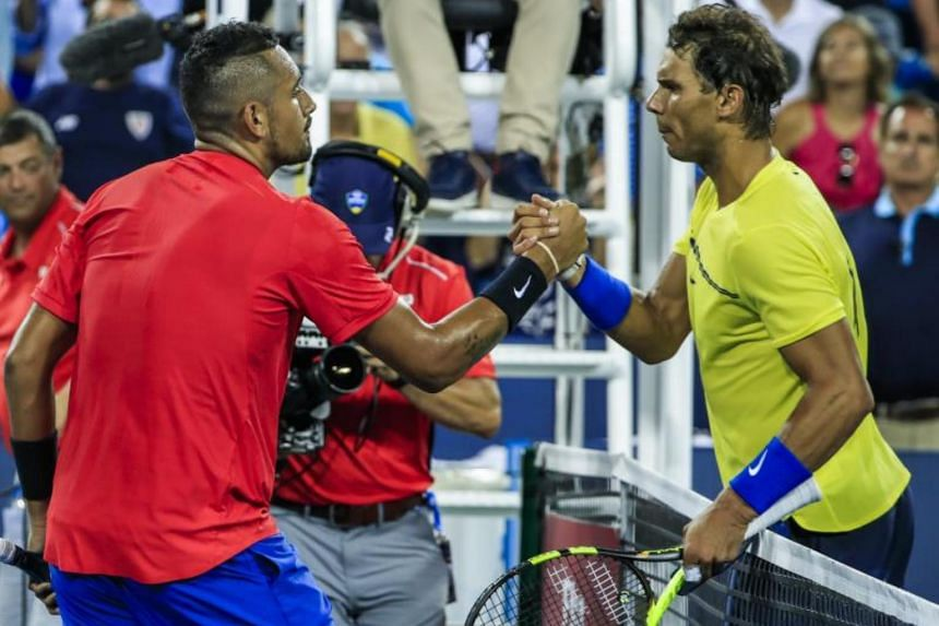 Rafael Nadal of Spain (R) shakes hands with Nick Kyrgios of Australia (L) after their match in the Western & Southern Open tennis tournament at the Linder Family Tennis Center on Aug 18, 2017.