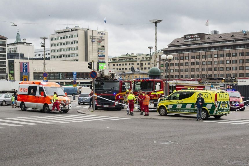 Rescue personnel have cordoned off the area at the Turku Market Square in the Finnish city of Turku where several people were stabbed, on Aug 18, 2017.