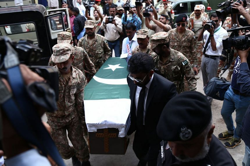 Pakistani Army soldiers carry the coffin containing body of Dr Ruth Pfau.