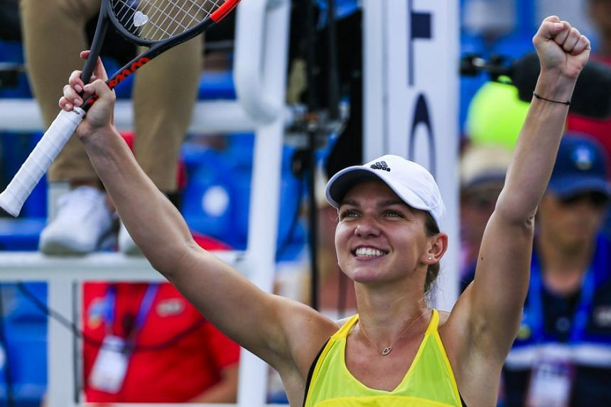 Halep celebrates after defeating Sloane Stephens of the US.
