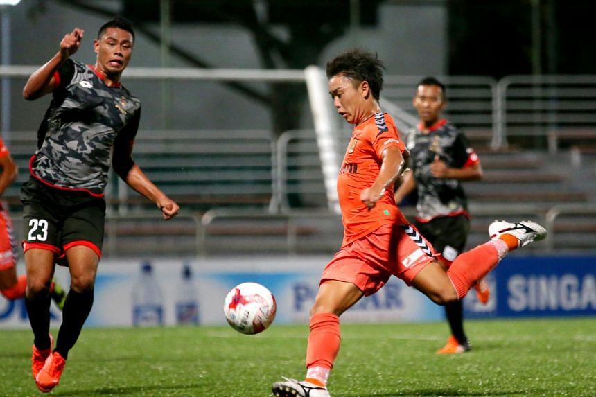 Albirex Niigata's Ryota Nakai (in orange) in action during their match against Brunei DPMM (in black) at Jurong East Stadium on March 9, 2017.