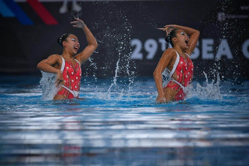 Miya Yong (left) and Debbie Soh of Singapore in action during their duet technical routine, on Aug 18, 2017.