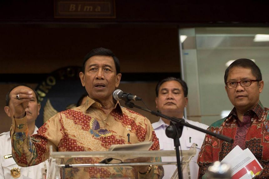 Indonesian Minister for Political, Legal, and Security Affairs Wiranto talks to reporters in Jakarta, on July 12, 2017.