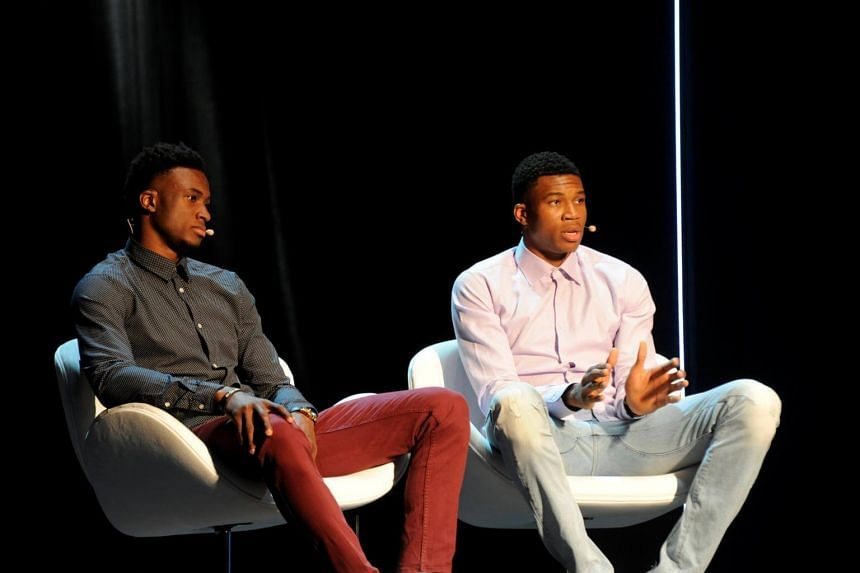Greek basketball players, brothers Thanassis (left) and Giannis Antetokounmpo attend an event at the Onassis Cultural Centre in Athens, on June 24, 2017.