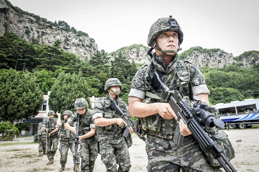 South Korean Marines patrolling along the coast of the eastern island of Ulleung as they take part their largest-ever training to defend the eastern island of Ulleung, The month-long drills involving 90 Marines started on Aug 18, 2017, and is separat