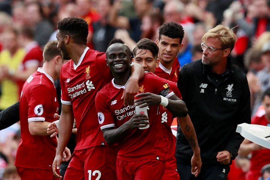 Sadio Mane (centre) celebrates scoring with Liverpool manager Juergen Klopp and team mates.