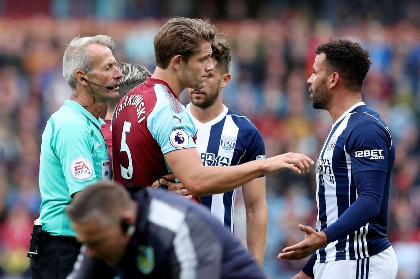 West Brom's Hal Robson-Kanu before being shown a red card by referee Martin Atkinson.