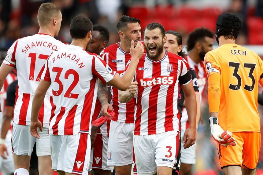Stoke City's Erik Pieters and team mates celebrate after defeating Arsenal.