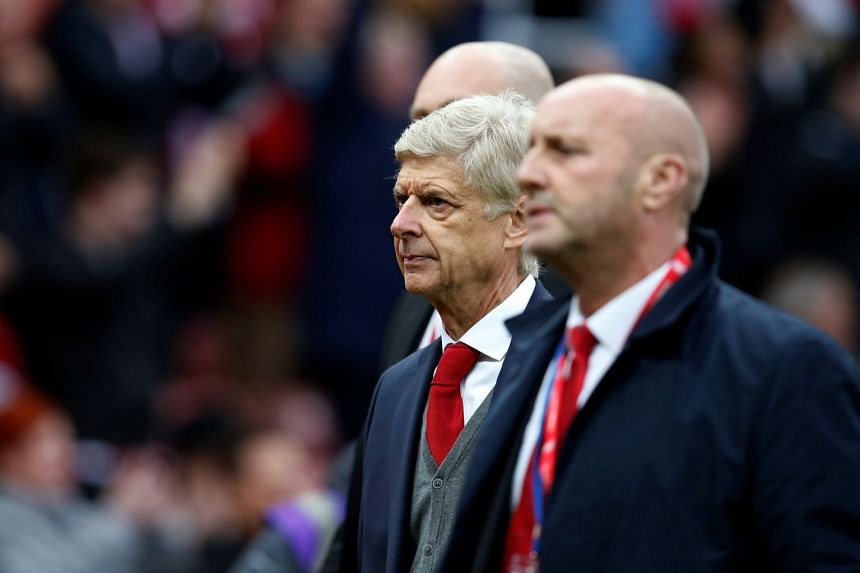 Arsenal manager Arsene Wenger looks dejected after the match.