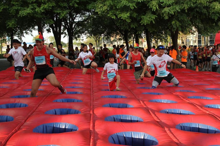 Participants navigating the Inflatable Stepping Stones at 5km Fun Run of the SAFRA Singapore Bay Run and Army Half Marathon, on Aug 20 2017.