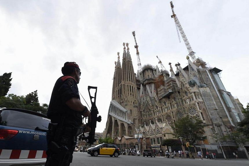 Police officers stand guard in front of the Sagrada Familia (Holy Family) basilica in Barcelona on Aug 19, 2017.