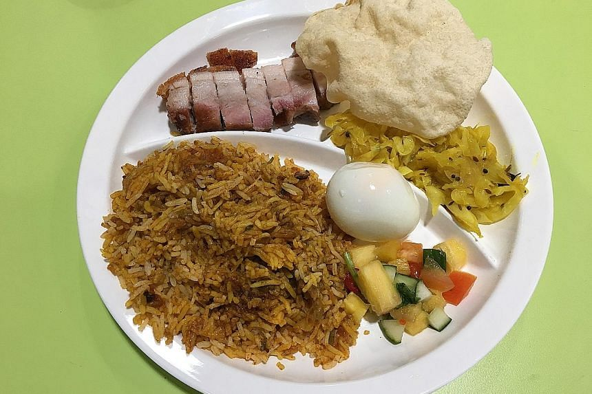 The siew yoke biryani fuses the Persian-Indian rice dish with Cantonese-style roast pork belly.